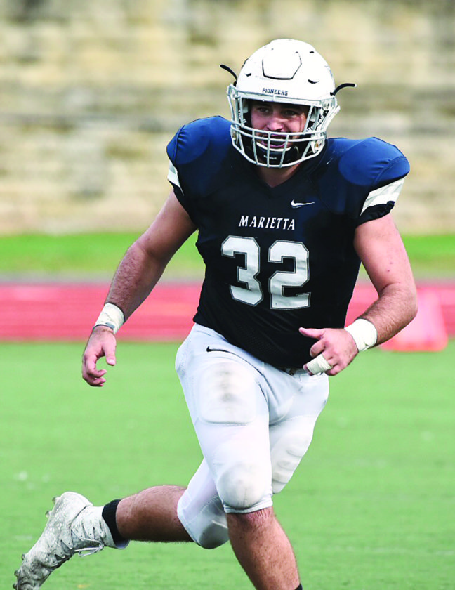 Photo courtesy of Nate Knobel Marietta College's Garrett Davis looks to make a play during a college football game against Heidelberg last Saturday at Don Drumm Stadium.