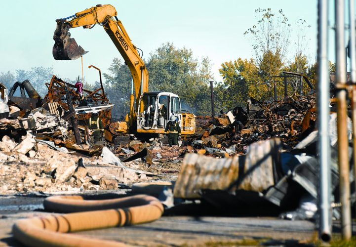 Photo by Jeff Baughan An excavator moves debris on Friday at the IEI warehouse fire on Camden Avenue. After a week, the fire is nearly out, officials said.