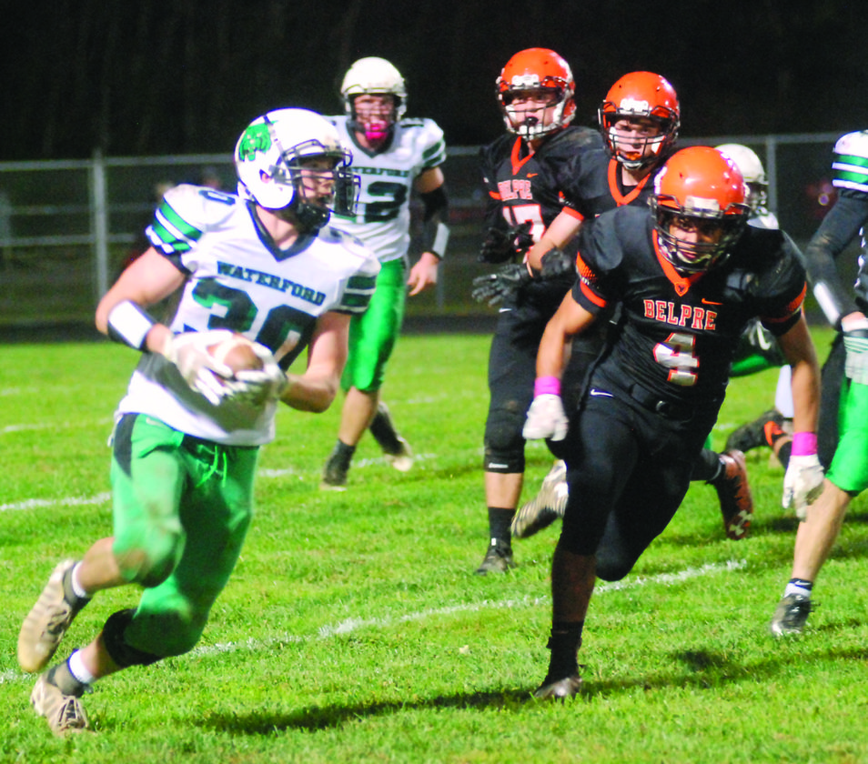 MIKE MORRISON The Marietta Times Waterford's Braden Bellville (30) carries the ball as Belpre's Tojzae Reams (4) tries to chase him down during a high school football game Friday at Ralph Holder Stadium. Waterford won, 44-3.