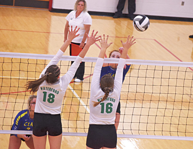 Photo courtesy of Kevin Colley Waterford's Megan Ball (18) and Denise Young (16) go up for a block during a high school volleyball district final match Saturday in Jackson.