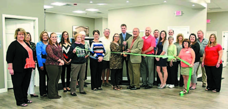 Belpre Area Chamber of Commerce members, friends, bank staff and fellow bankers celebrated the opening of the new Citizens bank Company facility at the corner of Farson St. and Washington Blvd. with a ribbon-cutting October 23. Pictured are: from left:Cathy Swain, Tammy Boggs, Caitlin Decker, Shelby Miller (Citizens staff); Amy Medley, Bickle Ins. and Century 21 Full Service Realty; Donna Miller, Belpre City Council; Bobbi Davis, BACC Board of Directors; Wendy Marcum, Citizens Bank; Bob Rauch, Main St./Farson St. Car Wash; Kathy Rupe, Citizens Security Officer; Todd Hilverding, Citizens President and CEO; Belpre Mayor Mike Lorentz;  Kevin Smart of Congressman Bill Johnson\'s office; Larry Arnold, President of Belpre Savings Bank Board of Directors; Kassandra Thorn, Belpre Branch manager; Judy Drake, Belpre City Council; Brad Offenberger, Peoples Bank Belpre Branch Manager; Nancy Miller, Miller Prosthetics and Orthotics; Kelly Cox, BACC Board vice-president;  Allison Adams, Citizens Bank staff; Mark Mondo of Mark Mondo Construction; and Paula Hedrick, Citizens staff.