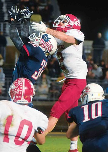 JEFF BAUGHAN The Marietta Times Parkersburg South's Tyee Gibson (32) and Parkersburg's Seth Dailey (2) go up for a ball during a high school football game Friday night at Erickson All-Sports Facility in Parkersburg.
