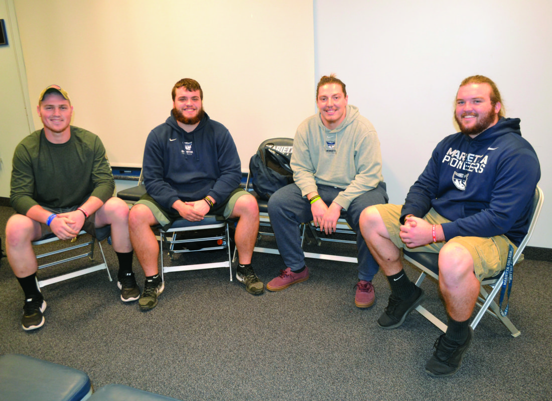 RON JOHNSTON The Marietta Times From left to right, Payton Henderson (right tackle), Brendan Mullholland (center), Anthony Jalowiec (left guard) and Caleb Riggleman (left tackle) help make up Marietta College's offensive line. The Pioneers are second in the Ohio Athletic Conference in rushing yards per game and are 6-3 this season, due in large part to the success of the guys up front.