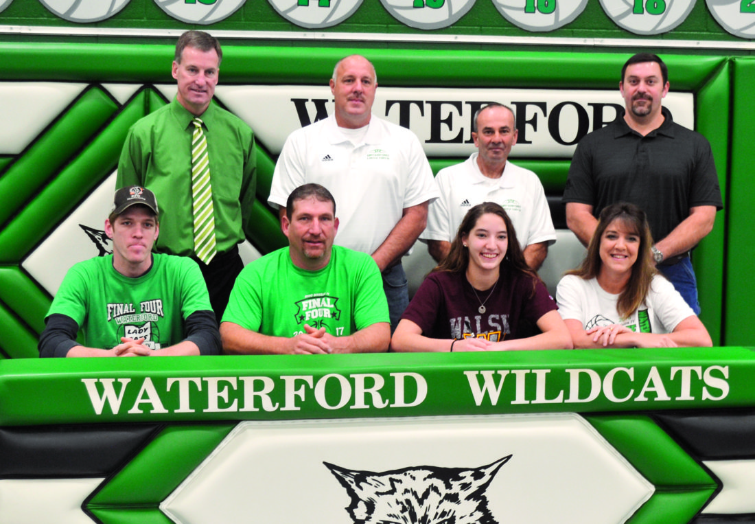 RON JOHNSTON The Marietta Times Waterford senior Megan Ball signed a National Letter of Intent to play college basketball at Walsh University Monday at the Harry Cooper Annex in Waterford. Sitting from left to right are Travis Ball (brother), Darren Ball (father), Megan, and Lisa Ball (mother). Standing, left to right, are Waterford assistant Todd Hilverding, head coach Jerry Close, assistant Kevin McCutcheon, and AAU coach Jeff Smith.
