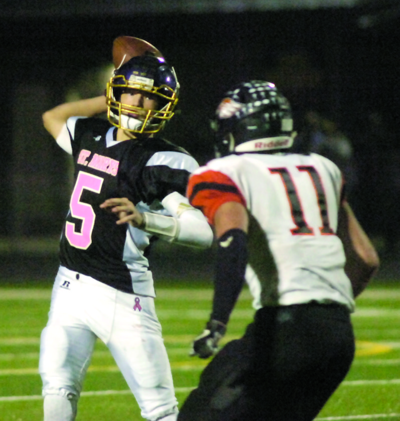 JOE ALBRIGHT The Marietta Times St. Marys' quarterback Eric Illar (5) thorws a pass during a high school football game against South Harrison earlier this season at Bill Hanlin Stadium. St. Marys is scheduled to play host to Doddridge County at 1:30 p.m. Saturday in a W.Va. Class A playoff game.