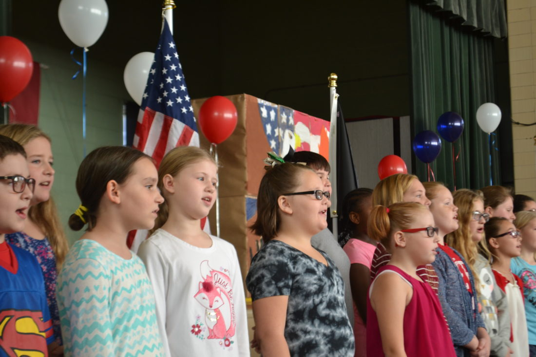 MICHAEL KELLY   The Marietta Times Children at Harmar Elementary School sing patriotic songs to honor their guest veterans on Thursday.