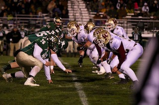 Photo by Neal Smith Players for East Hardy, left, and Williamstown, right, line up for a play during Friday's Class A playoff football game in Baker, W.Va.