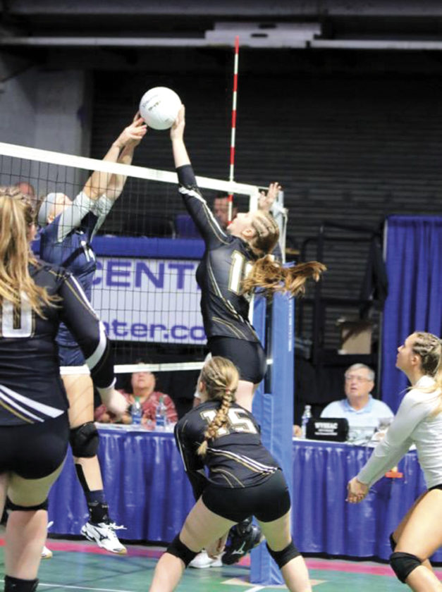 Photo by Michael Uhl Williamtown's Kayla Bauman, right, attempts to spike the ball during a high school volleyball W.Va. Class A state tournament match against Ritchie County Friday in Charleston, W.Va.