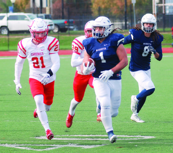 JORDAN HOLLAND The Marietta Times Marietta College's Roger Walker (1) runs with the ball as teammate Alex Smith (8) looks on during a college football game against Otterbein Saturday at Don Drumm Stadium.