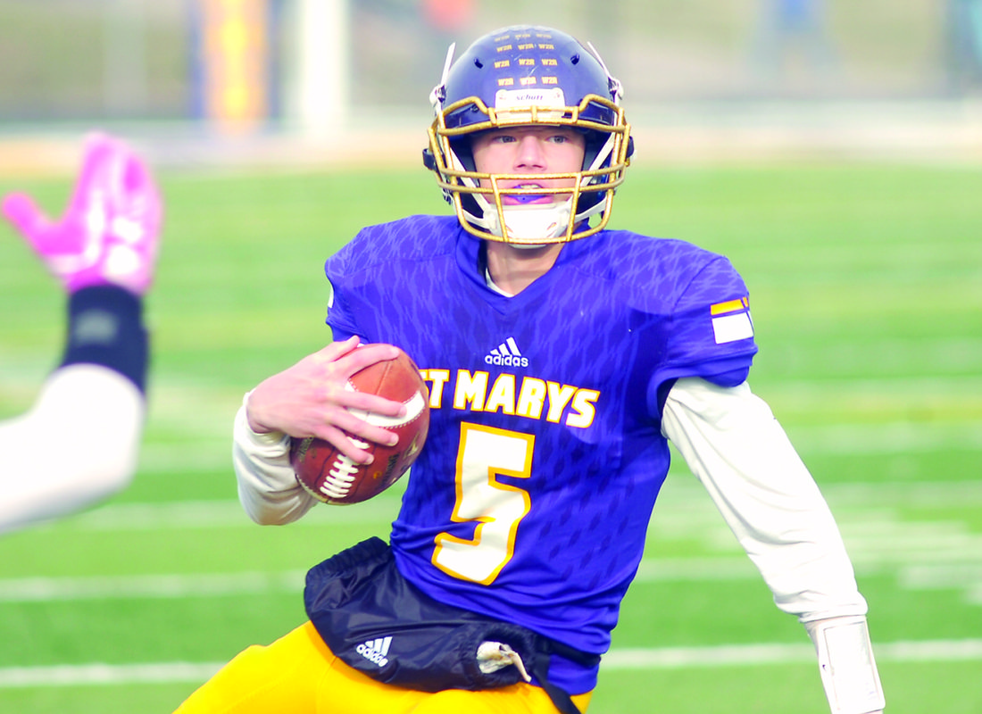 JOE ALBRIGHT The Marietta Times St. Marys' quarterback Eric Illar (5) carries the ball during a W.Va. Class A high school football playoff game against Doddridge County last week at Bill Hanlin Stadium.
