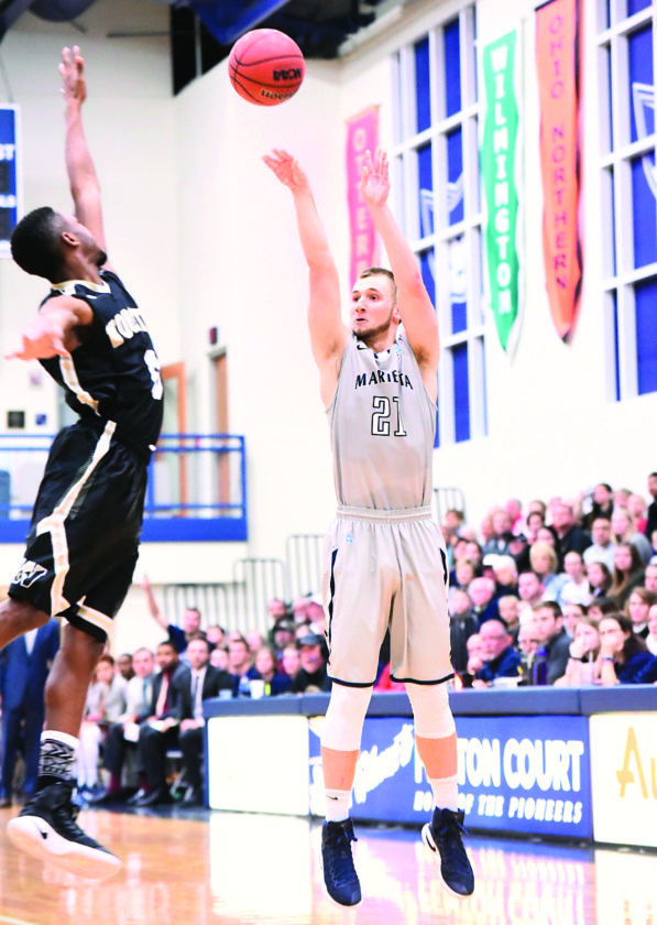 Photo courtesy of Nate Knobel Marietta College's Kyle Dixon (21) attempts a shot during a college men's basketball last season at Ban Johnson Arena.