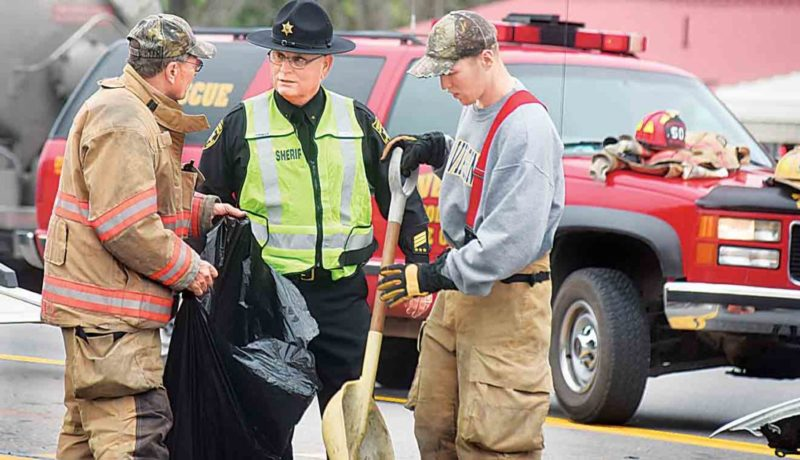 Wood County Sheriff Steve Stephens speaks with Waverly Volunteer Fire Department members at the scene of two-car accident Wednesday afternoon that resulted in a fatality. The roadway in the Valley Mills Road area was closed to one lane during the clearing of the scene. (Photo byJeff Baughan)