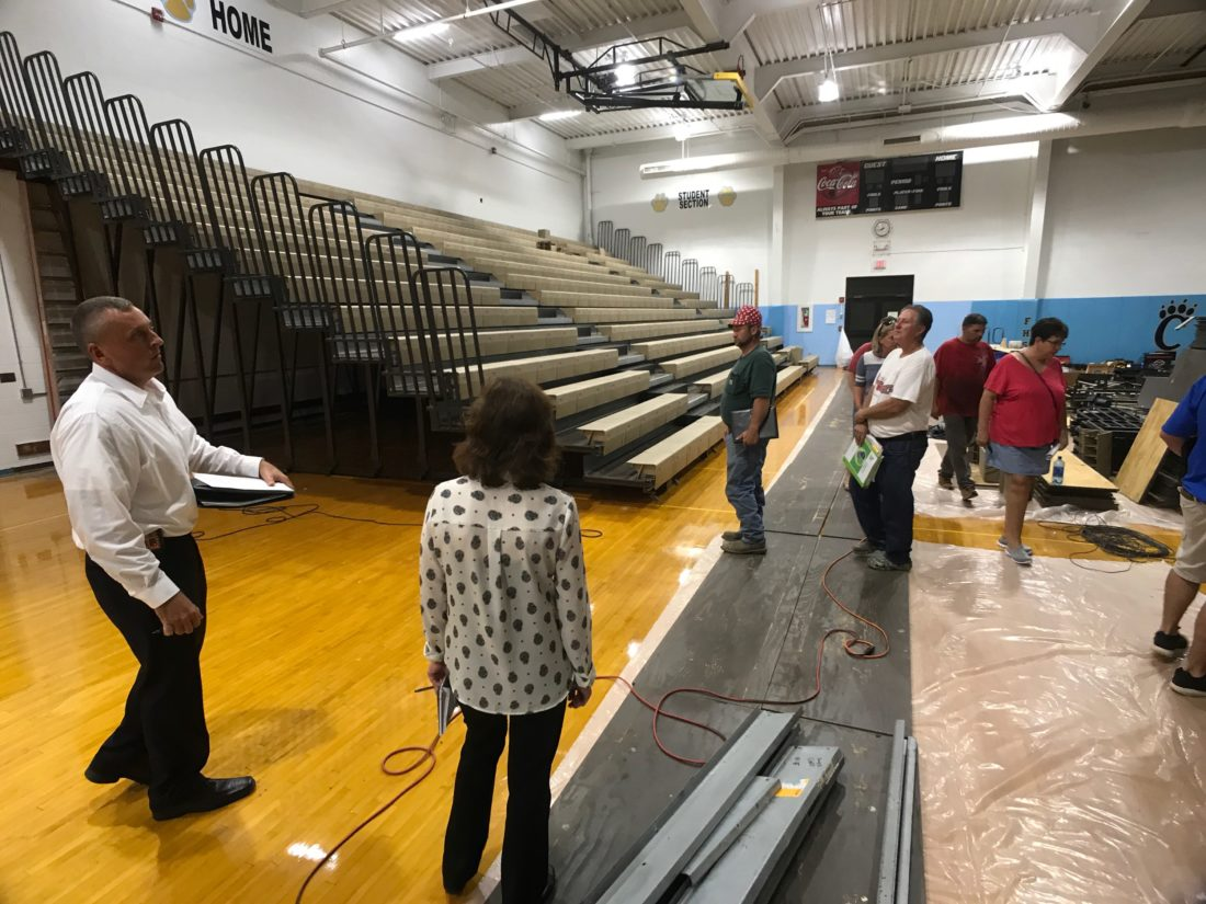 Times file photo Frontier Local Schools Superintendent Brian Rentsche, left, shows school board members and visitors around the high school gymnasium to see construction progress after a board meeting in August. The district invested heavily in new facilities in the early 2000s, but subsequently has seen its enrollment decline by more than one-third. All districts in Washington County have seen students numbers fall during the same period.
