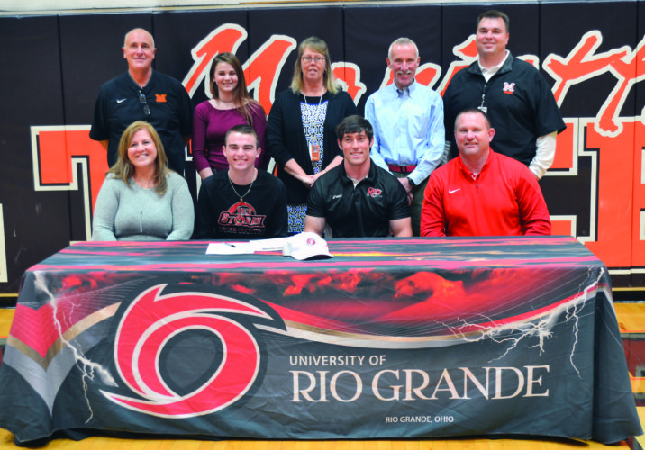 RON JOHNSTON The Marietta Times Sitting, left to right: Natalie Doughty (mother), Collin Doughty, Craig Dougherty (University of Rio Grande assistant coach), and John Doughty (father). Standing: left to right, Rick Guimond (MHS athletic director), Isabelle Doughty (sister), Mollie Schramm (MHS track&field coach), Dale Leeper (MHS cross country coach), and Chris Laumann (MHS assistant principal).