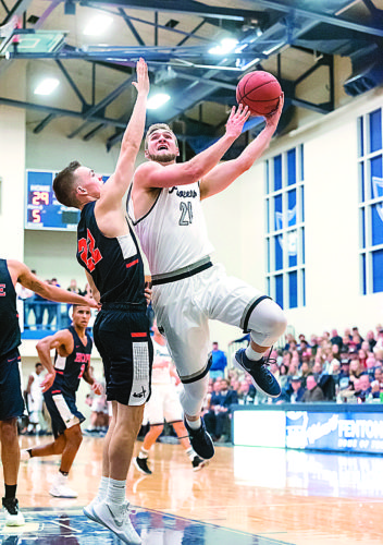 Photo courtesy of Nate Knobel Photography Marietta College's Kyle Dixon (21) goes up for a basketball during a college men's basketball Great Lakes Invitationl Tournament game against Hope Friday night at Ban Johnson Arena. Marietta won, 102-71.