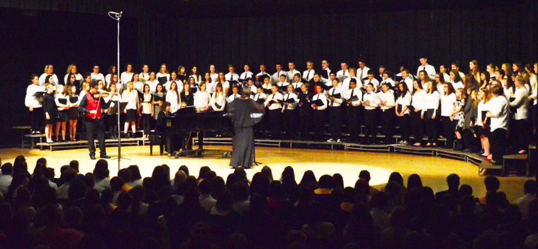 DOUG LOYER  Special to the Times Ann Lillie-Briggs directs the combined Middle School Honors Choir on the Warren High School auditorium stage. Hundreds of Middle and High School students participated in the OMEA District IX Honor Choir Festival Saturday.