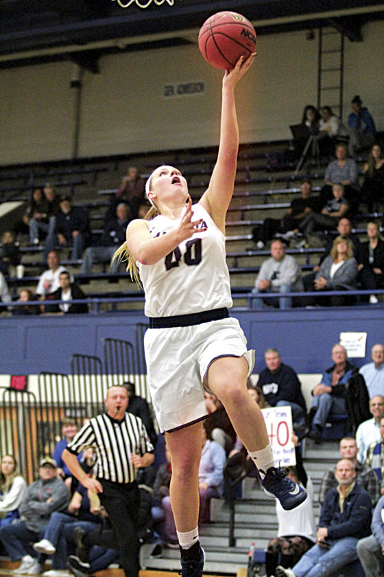 Photo by France Moise Marietta College's Corrie Burkhardt goes up for a layup earlier in the season opener. Burkhardt and the rest of the Pioneers host the 33rd Jim Meagle Turkey Shootout inside Ban Johnson Arena this weekend.