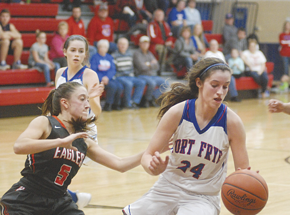 Fort Frye's Kelsey Adkins (24) is guarded by Belpre's Sydney Spencer (5) during a high school girls basketball game Monday evening in Beverly. Fort Frye scored a 38-27 win in the season opener for both Washington County schools. Photo by Mike Morrison.