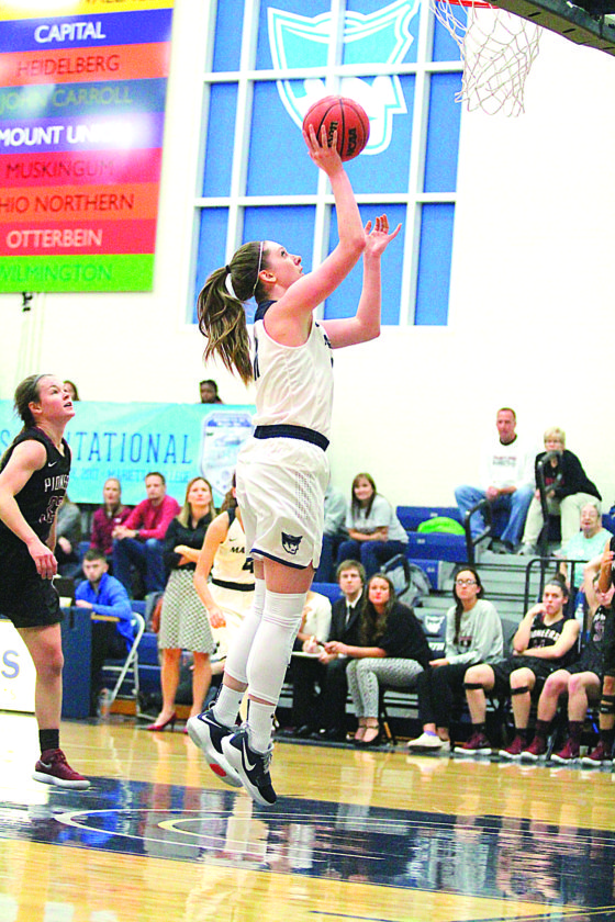 Marietta College's Alexis Enochs drives to the basket during a college women's basketball game earlier this season at Ban Johnson Arena.  Photo courtesy of France Moise