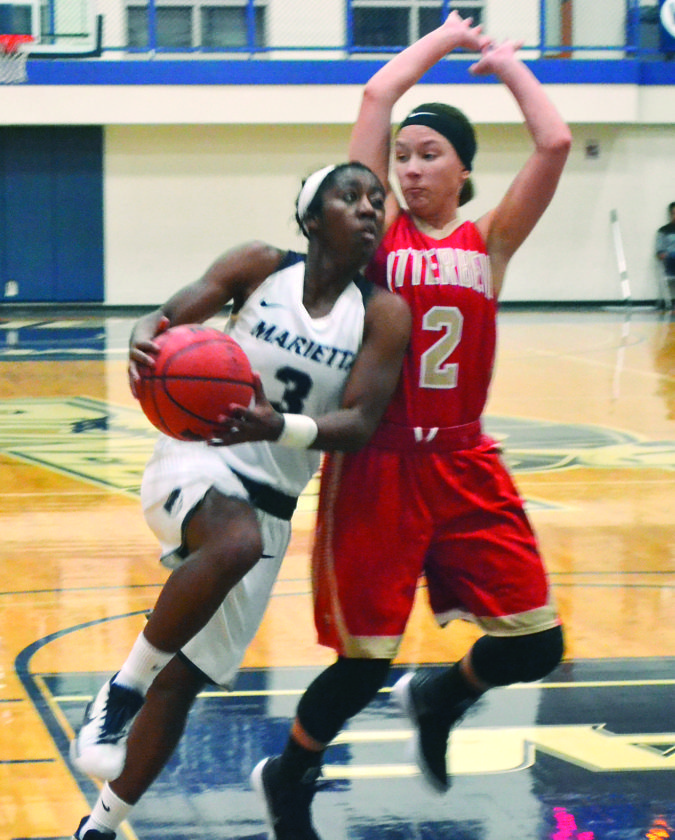Marietta College's Amisha Herd drives with the ball during a college women's basketball game against Otterbein Wednesday at Ban Johnson Arena.  RON JOHNSTON The Marietta Times