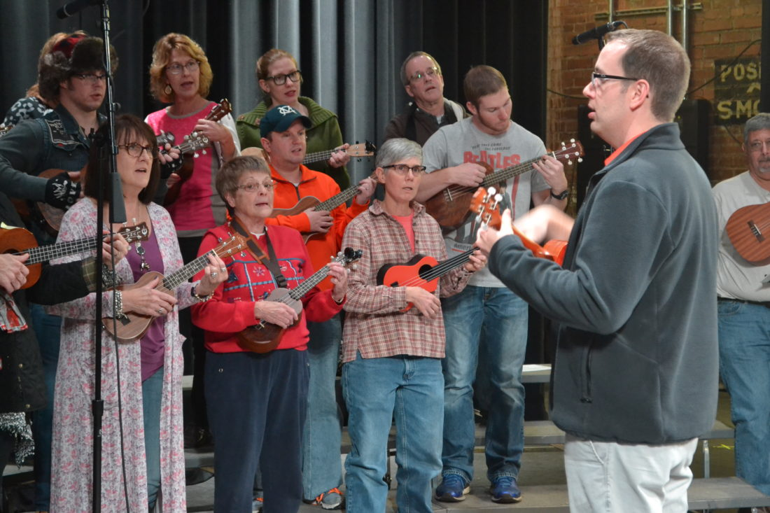 ERIN O'NEILL   The Marietta Times Steve Brown, right, director of the Marietta Ukelele Choir, leads the group of around 60 members in a Christmas tune on Tuesday during rehearsals for the second annual Hometown Holiday Spectacular.