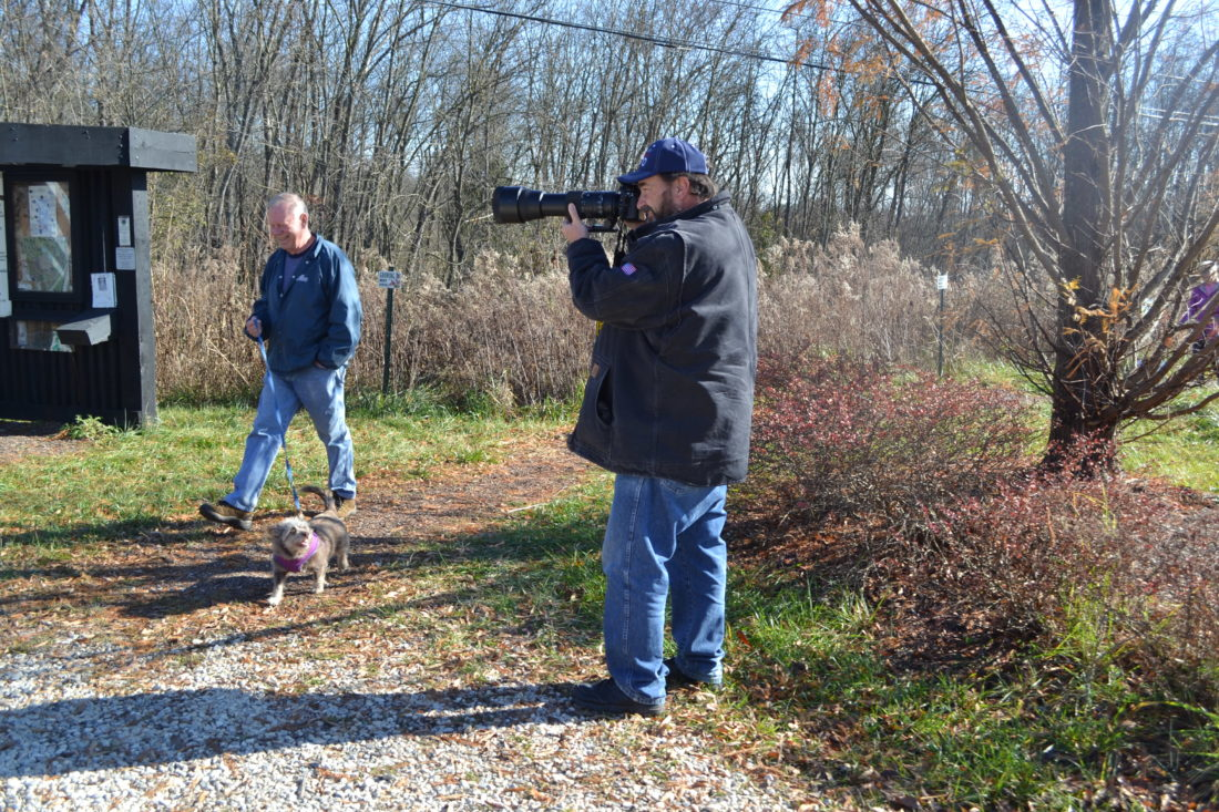 ERIN O'NEILL  The Marietta Times Local photographer Bruce Wunderlich, as well as Marietta resident Russell Schreiber and his dog Brownie, take advantage of the beautiful weather Wednesday to visit the Kroger Wetlands. A partnership with Kroger, the City of Marietta and volunteers has seen upgrades to the wetland.