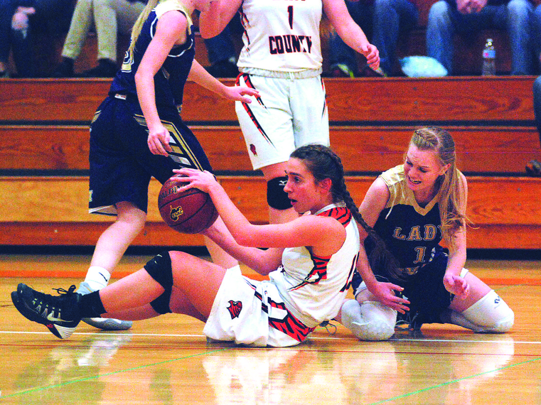 JAY W. BENNETT The Marietta Times Wirt County's Taylor Anderson, left, comes away with a loose ball as St. Marys' Addie Furr reacts during a high school girls basketball game Thursday in Elizabeth, W.Va.