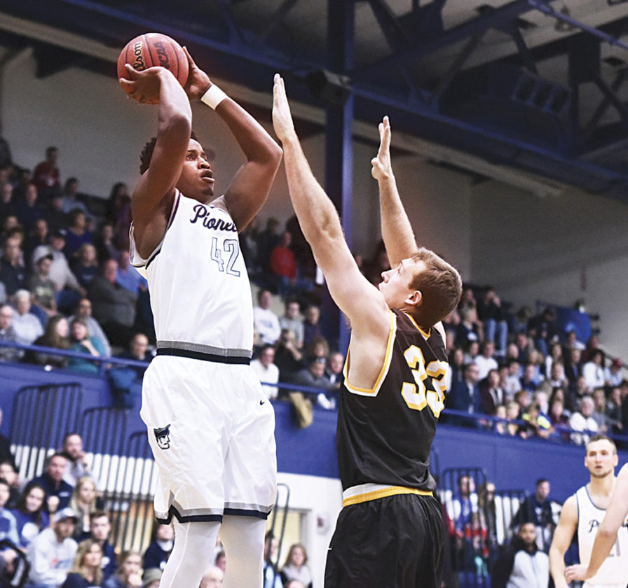 Photo courtesy of Nate Knobel Marietta College's Avery Williams (42) goes up for a jump shot during a college men's basketball game against Baldwin Wallace Saturday at Ban Johnson Arena.