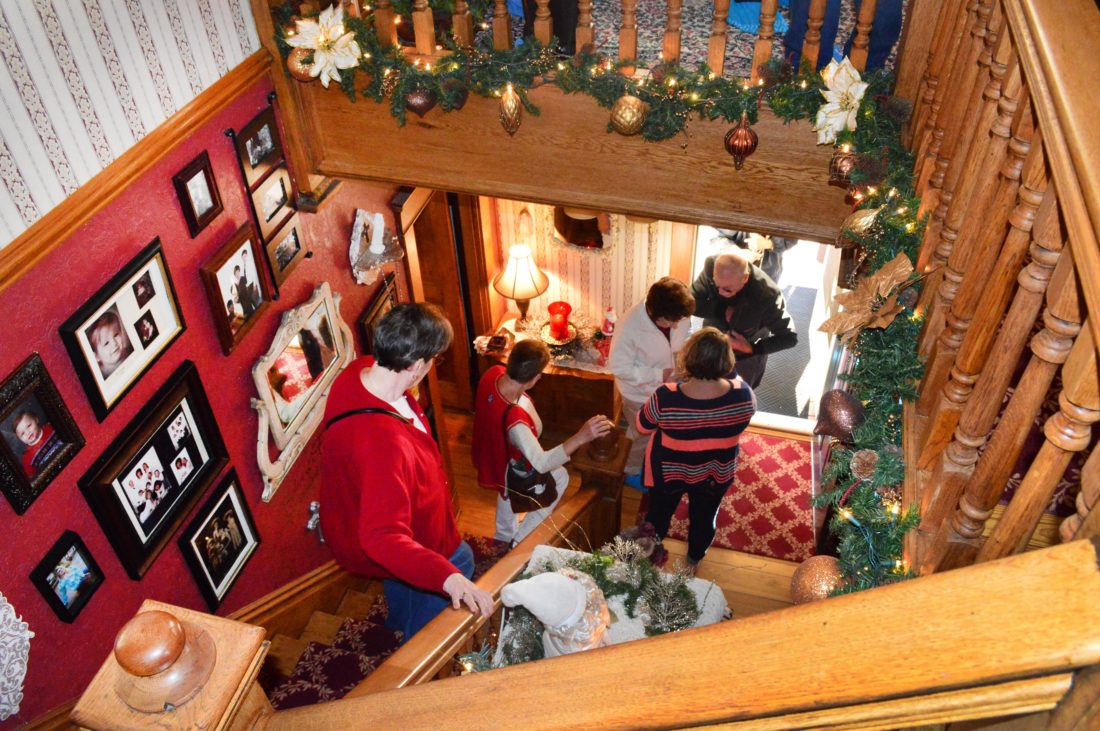 A view down the staircase at Gary Pitt's house on the Lowell Weihnachten Tour shows more tour goers arriving.