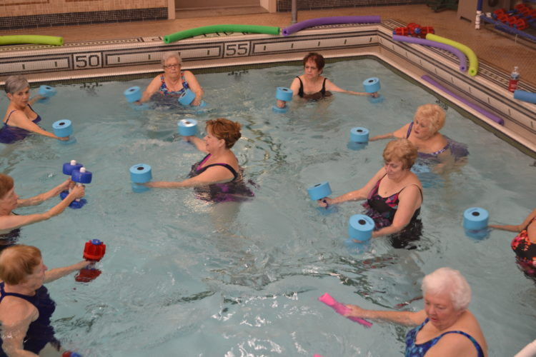 ERIN O'NEILL   The Marietta Times Carol Stacy leads a group arthritis exercise class at the Betsey Mills Club pool Monday. Three different classes are offered in the heated pool as an option to keep active through the winter months.