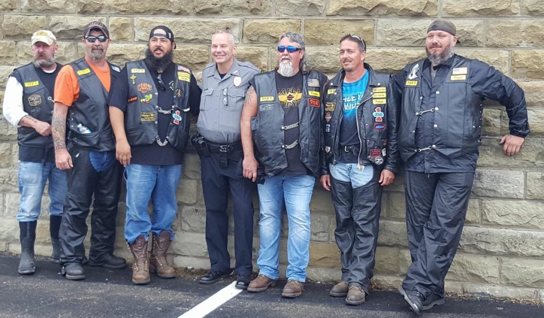 Photo submitted by Donnie Washburn Members of the Tramps Motorcycle Club pose with Marietta Police officer AJ Linscott during a past toy run to raise money for children in the foster care program.