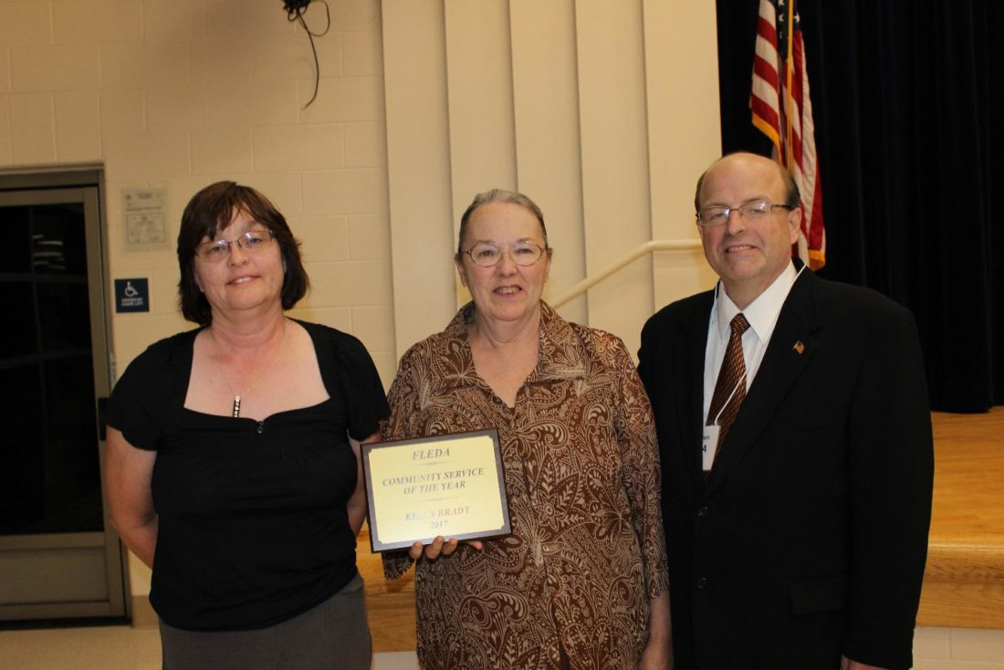 """""""Community Service of the Year Award"""" (New Matamoras Public Library – Kelly Brady) Pictured L to R:  Becky Minder, Debbie Noland and Mike Webber."""