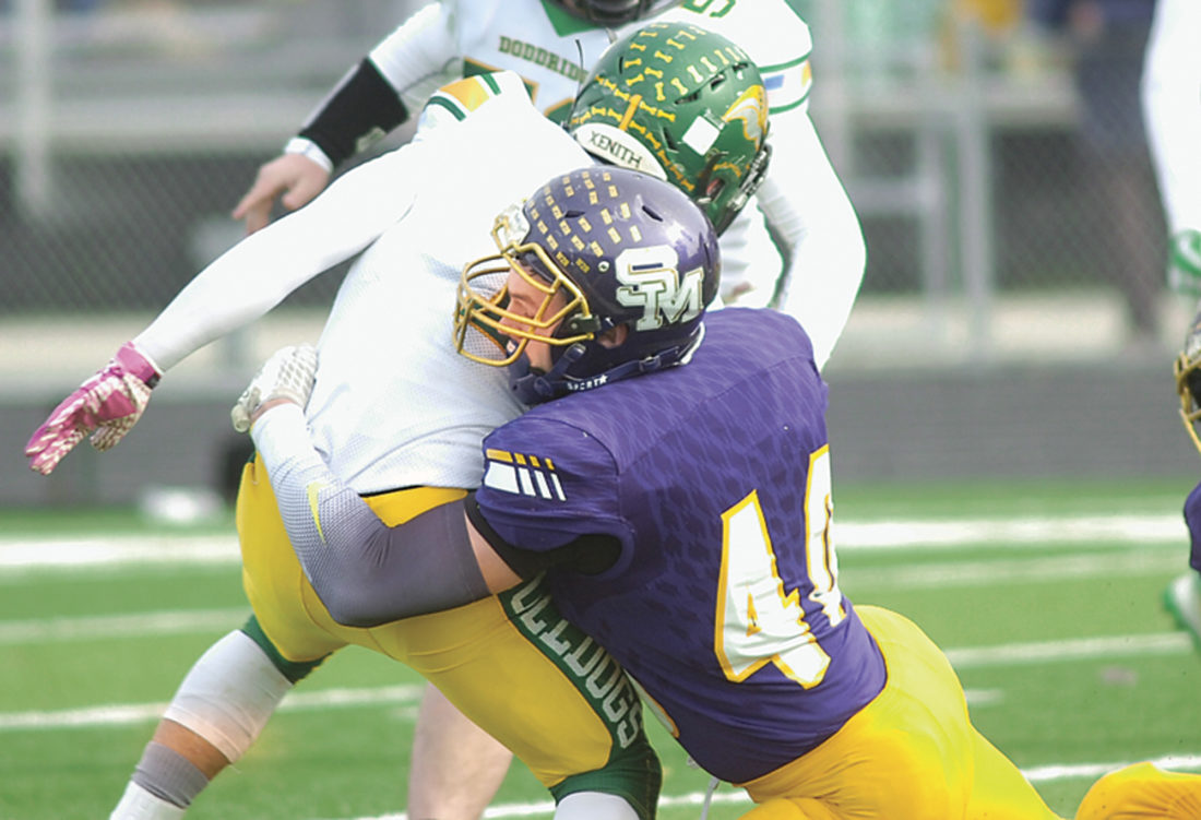 Joe Albright, THE MARIETTA TIMES  St. Marys' defensive end Dylan Gray brings down Doddridge County's Hunter America during a first-round playoff game. Gray was named to the W.Va. Class A All-State First Team as voted on by the West Virginia Sports Writers Association.