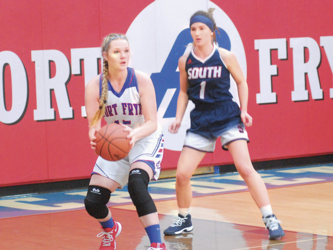 Mike Morrison, THE MARIETTA TIMES  Fort Frye's Kiersten Kesselring (15) looks for an open teammate, while defended by Parkersburg South's Kenzie Johnson during the Patriots' 63-39 win over the Cadets