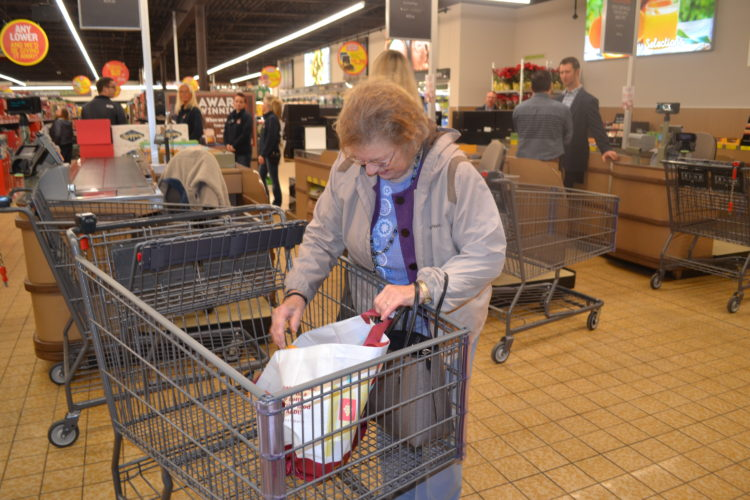 ERIN O'NEILL  The Marietta Times Val Hoover, of Marietta, was the first to check out at the Marietta Aldi after it reopened Tuesday with a new design.