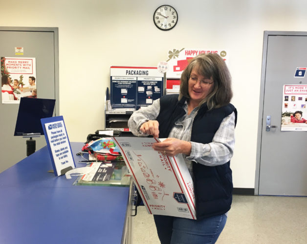 ERIN O'NEILL  The Marietta Times Kelly Hardman, of Marietta, prepares Christmas gifts to be shipped to Sweden Wednesday at the Marietta Post Office. Deadlines for sending out packages to arrive by Dec. 25 are quickly approaching.