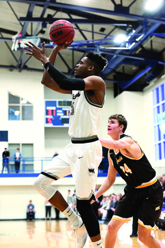 Photo courtesy of Nate Knobel Photography Marietta College's DeVaughn Wingard, left, shoots during a college men's basketball game against Baldwin Wallace earlier this season at Ban Johnson Arena.