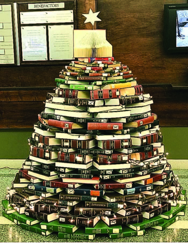 Book Tree Made from pulled editions of encyclopedias, older versions of the Ohio Revised Code and other retired works the Marietta College Legacy Library welcomes students during the last weeks of school with a Christmas tree in the front lobby.