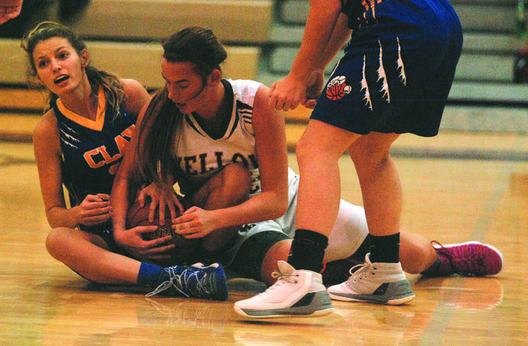 JAY W. BENNETT The Marietta Times Williamstown's Jenna Pridemore and Clay County's Kacey Butcher battle for a loose ball during the semifinals of Friday night's Donnie Fenton Shootout.
