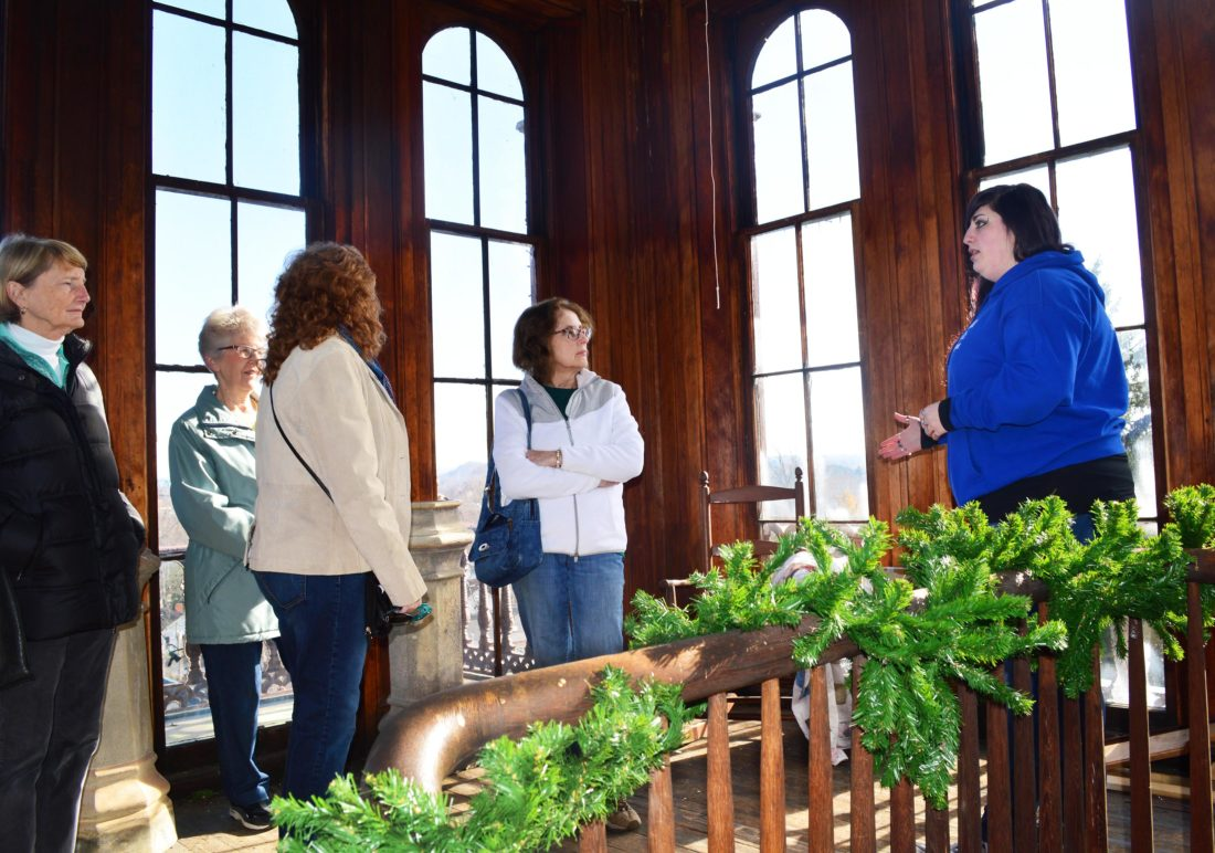 Hidden Marietta Tour Co. Tour Guide Kat Watkins talks with tour-goers in the tower of the Anchorage as they take in views of Marietta.