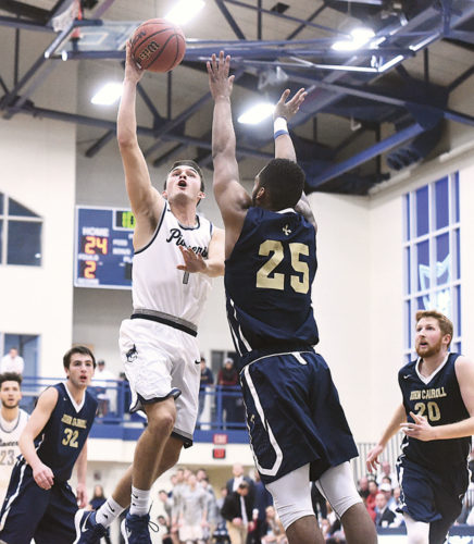 Marietta College's Dillon Young (1) goes up for a basket during a college men's basketball game against John Carroll Saturday at Ban Johnson Arena in Marietta. Photo courtesy of Nate Knobel.