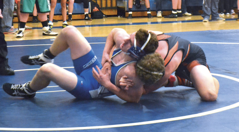 Warren's Cole Hupp wrestles with New Lexington's Jacob Vance Saturday in the Hickory Grove Invitational at Warren High School. Vance won by decision in the 145-pound weight class. Photo Mike Morrison.