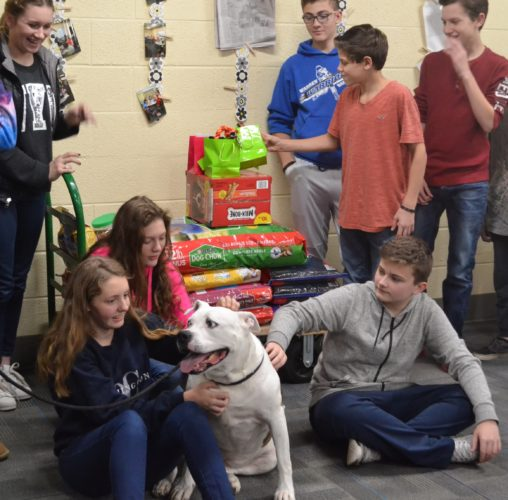 ERIN O'NEILL  The Marietta Times Students in Warren Middle School teacher Josie Bintz's character group were visited by Sammi, an 8-year-old American bulldog who is currently at the Humane Society of the Ohio Valley. The students raised money to buy much needed supplies for the shelter as part of a citizenship project and Beth and Don Underwood, volunteers at the shelter, were there to thank the students personally. Sammi is available for adoption, has been spayed and her fee is $125.