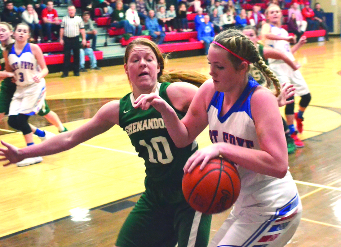 MIKE MORRISON The Marietta Times Fort Frye's Kiersten Kesselring, right, handles the ball as Shenandoah's Jacie Clifton defend during Monday's game.