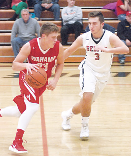 STEVE HEMMELGARN The Marietta Times Belpre's Cole Knotts (3) guards Wahama's Brady Bumgarner (23) during the host Golden Eagles' 69-63 over the White Falcons Tuesday night.