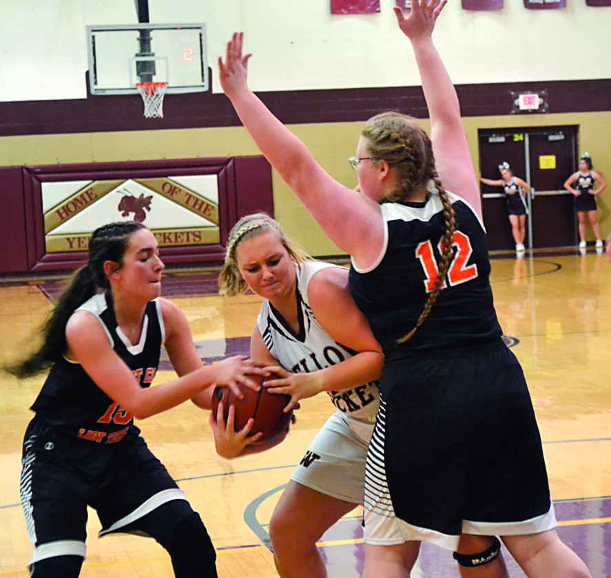 RON JOHNSTON The Marietta Times Williamstown's Breanna Lowe, center, is defended by Wirt County's Taylor Anderson, left, and Shelby Simonton, right, during a high school girls basketball game Tuesday.