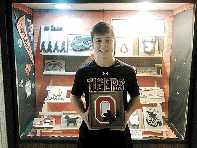 Photo submitted Marietta High School Sophomore Dakota Miller is seen here with one of his scroll saw creations.