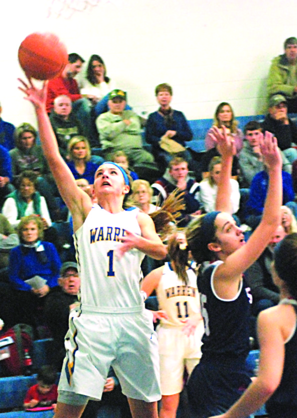 JORDAN HOLLAND The Marietta Times Warren's Kate Liston drives and goes up for a basket during a high school girls basketball game against Parkersburg South Wednesday in Vincent. South won, 48-42.