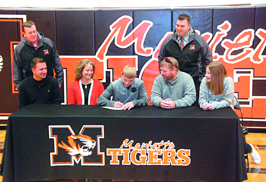 JORDAN HOLLAND The Marietta Times Marietta High senior Caleb Scharff had his signing ceremony Monday at Sutton Gymnasium. Next fall, Scharff will be a member of the Ohio Valley University golf team. Pictured above, from left to right, Chad Deem (MHS golf coach), Mandy Scharff (mother), Caleb Scharff, Brian Scharff (father) and Madelyn Scharff (sister).