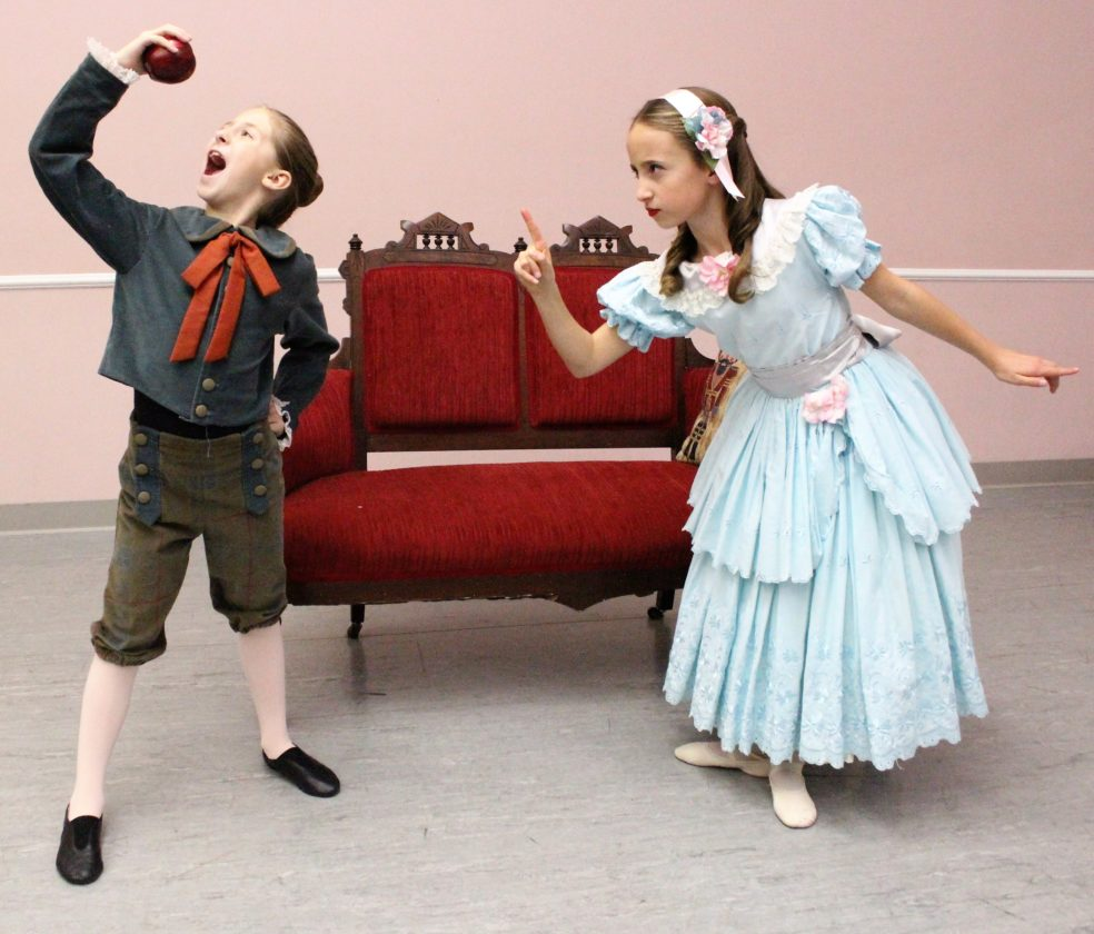 """Photo provided Young Clara (danced by Anna Martin) scolds brother Fritz (danced by Josie Augenstein) for stealing an apple in Schrader Youth Ballet's upcoming production of """"The Nutcracker (Clara's Dream)"""""""